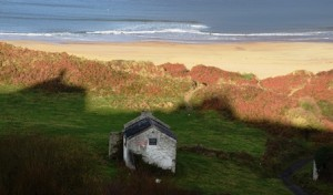 A hedge school shed on White Park Bay in Northern Ireland